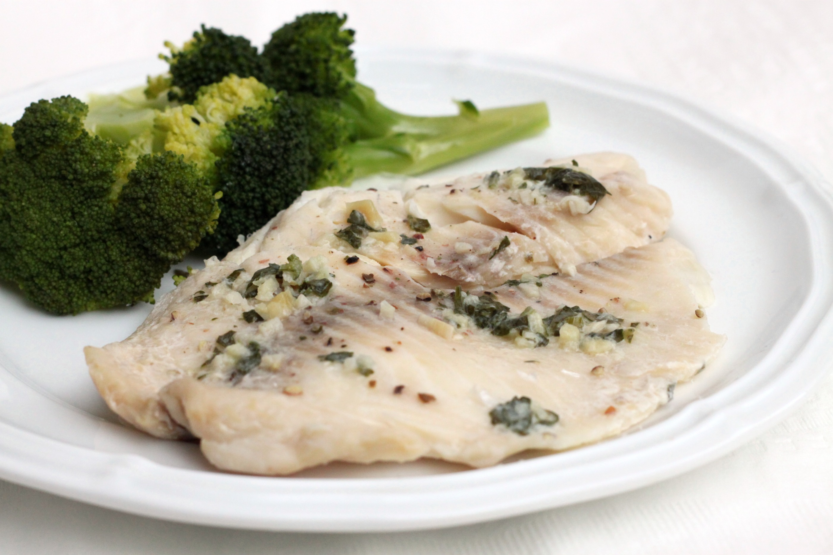 Slow cooker garlic butter tilapia 52 kitchen adventures for How to bake tilapia fish